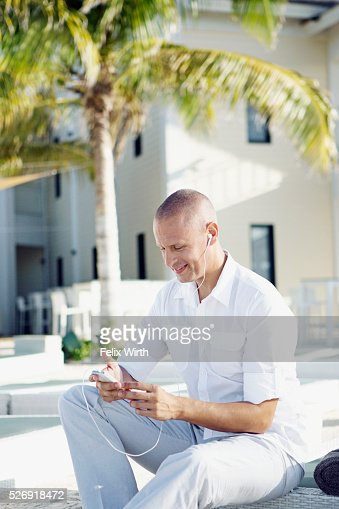 Portrait of man using mp3 player : Stock Photo