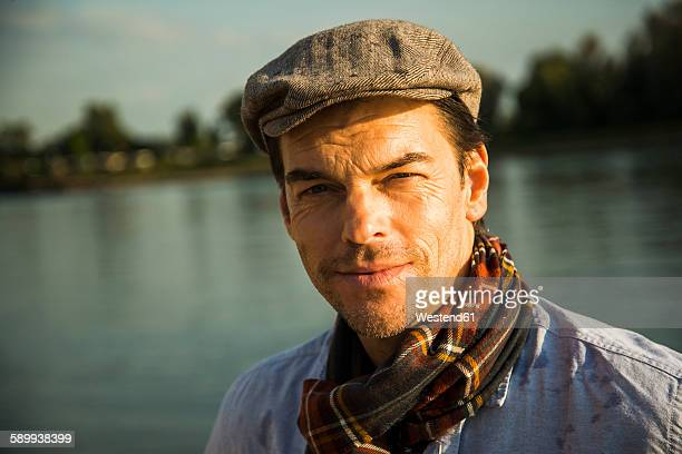 Portrait of man wearing cap at evening twilight