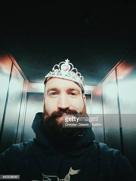 Portrait Of Man Wearing Crown In Elevator