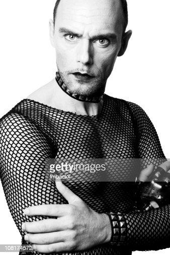 Portrait of Man Wearing Fishnet Shirt and Lipstick
