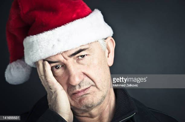 Portrait of man wearing Santa hat