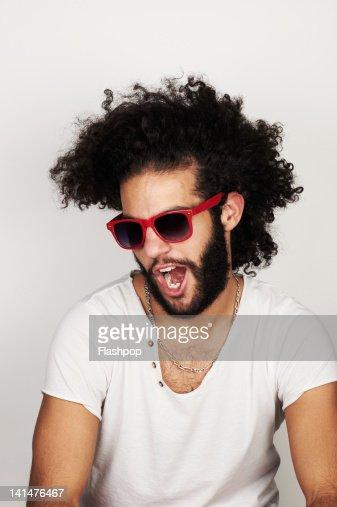 Portrait of man wearing sunglasses : Stock Photo