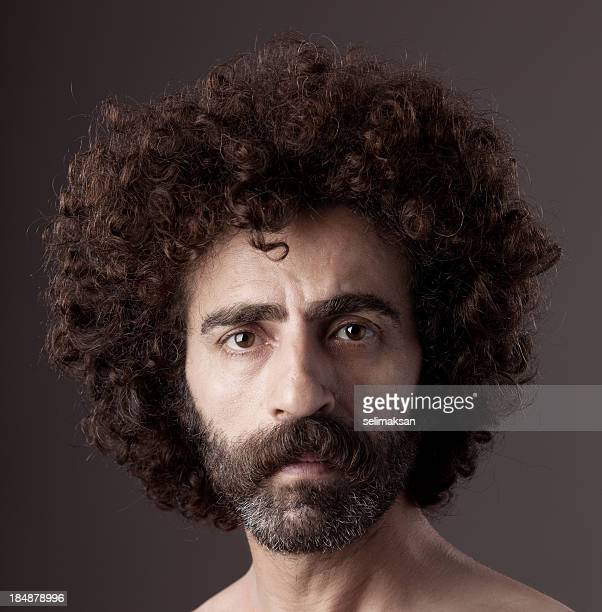 Portrait of man wiht curly hair and beard