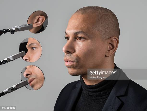 portrait of man with 3 round mirrors