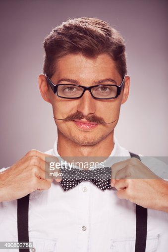 Portrait of man with a mustache and glasses