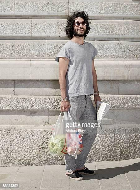 portrait of man with beard in street