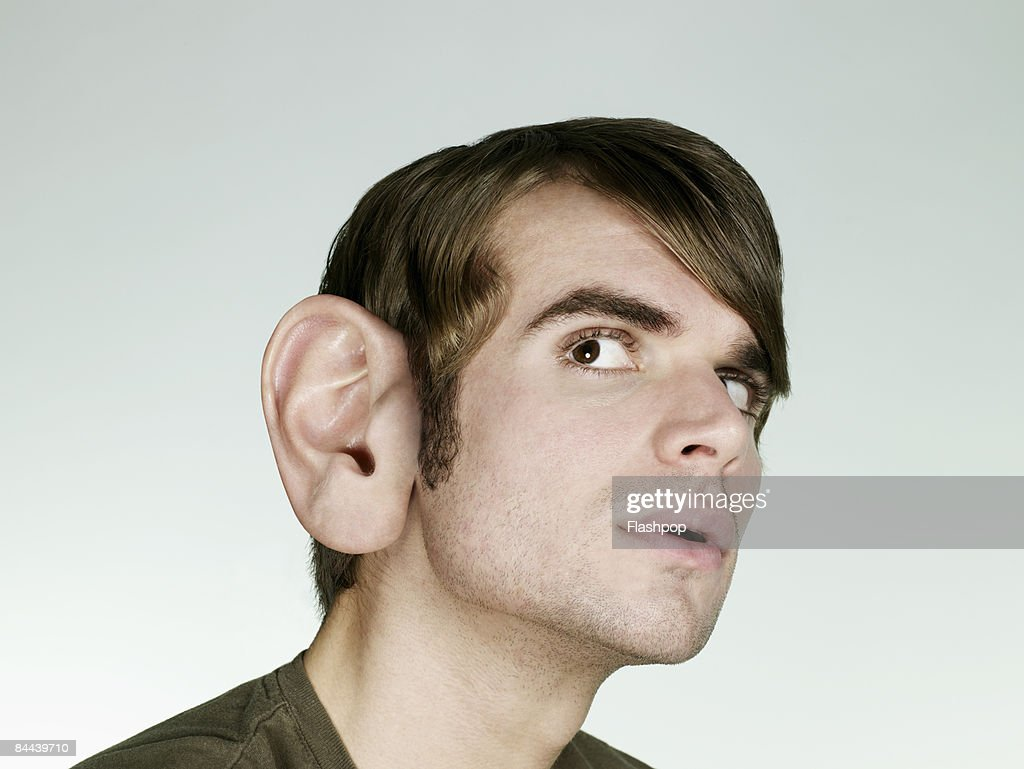 Portrait of man with big ear listening