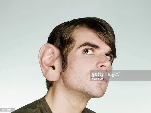 Portrait of man with big ear listening