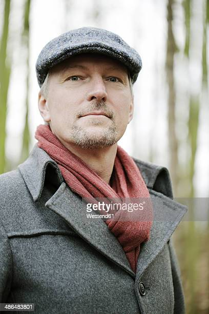 Portrait of man with cap in the wood