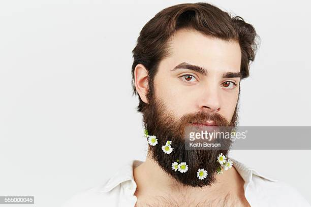 Portrait of man with flowers in beard