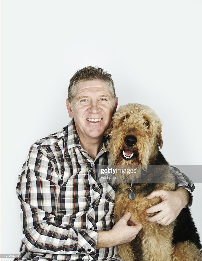 Portrait of man with his pet dog : Stock Photo