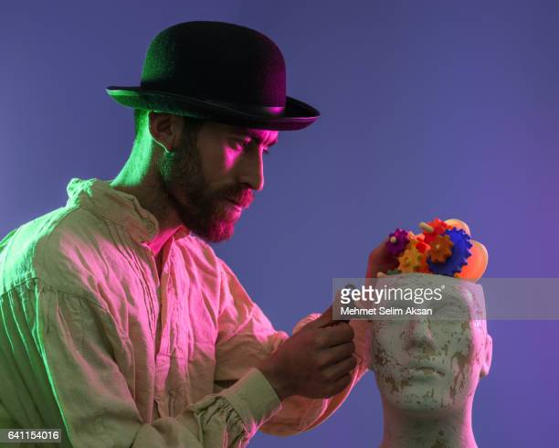 Portrait Of Man With Mannequin Head Full Of Gears