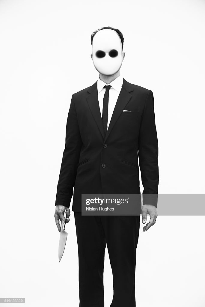 portrait of man with mask on and knife in hand : Stock Photo