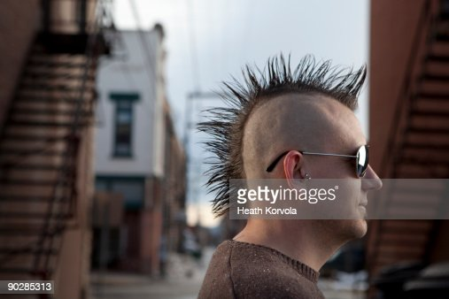 Portrait of man with mohawk in urban setting : Stock Photo