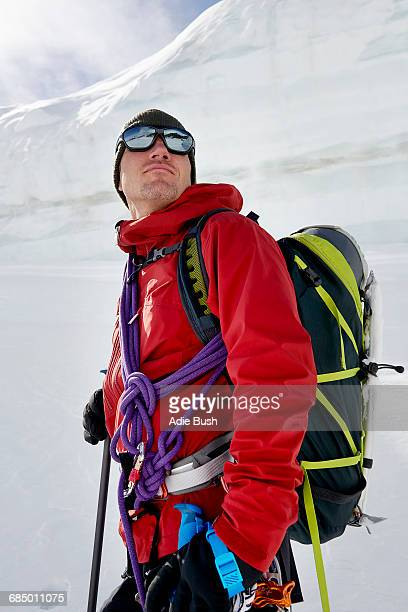 Portrait of man with mountaineering equipment looking away