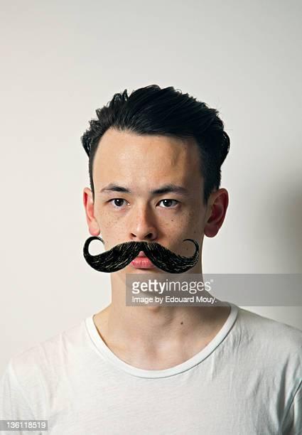 Portrait of man with moustache
