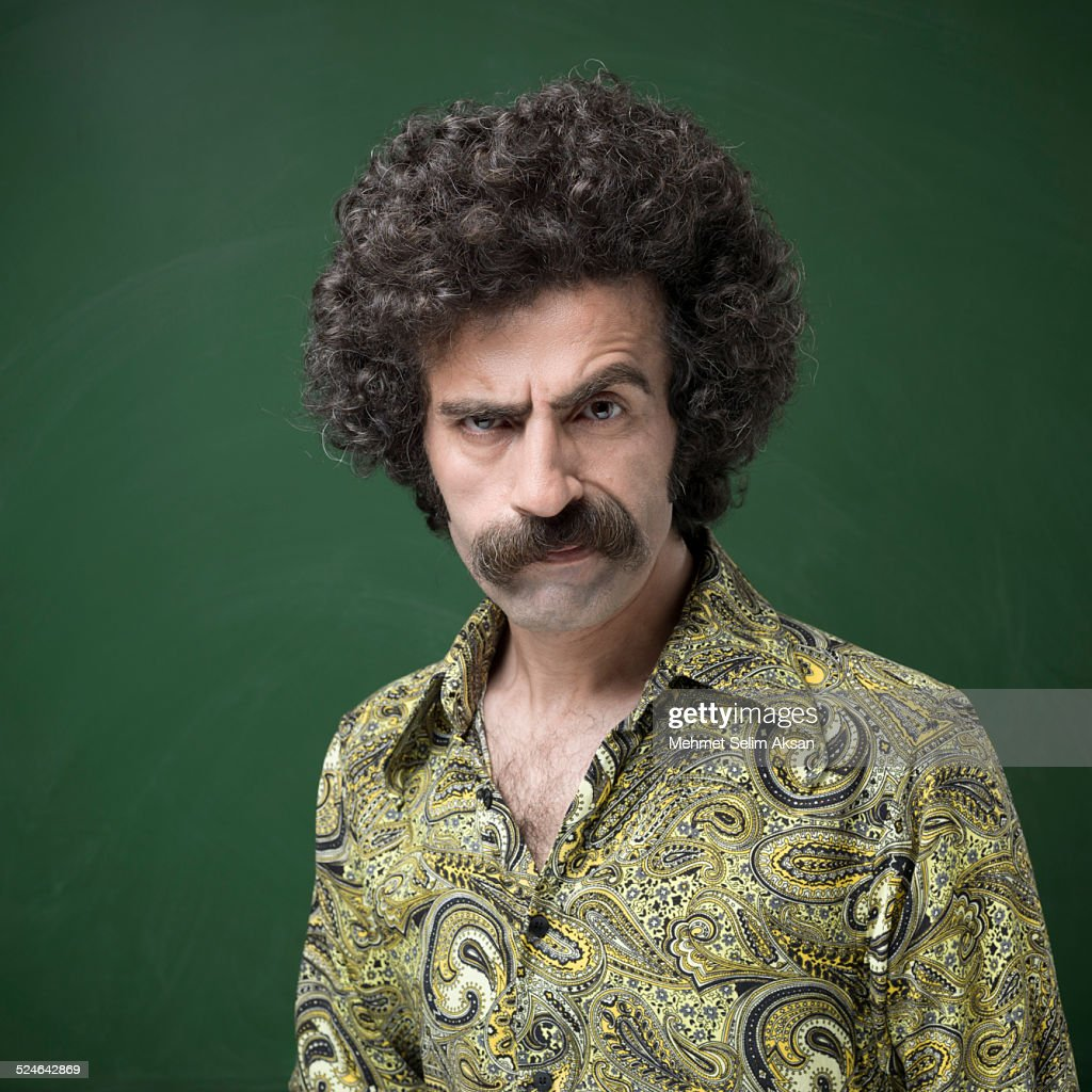 Portrait of man with mustache in 1970s style