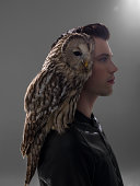 Portrait of man with Owl perched on shoulder