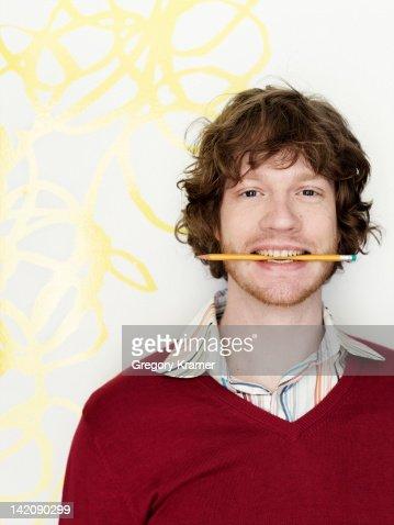 Portrait of man with pencil : Foto de stock