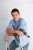portrait of man with power tool