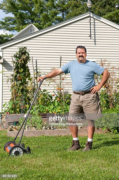 Portrait of Man with Push Lawn Mower