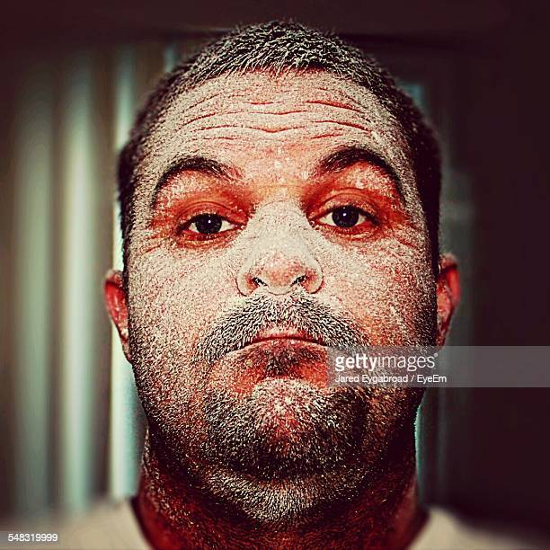 Portrait Of Man With Sand On Face