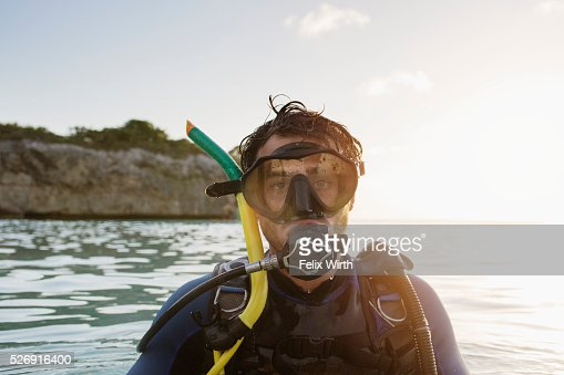 Portrait of man with scuba diving equipment in sea : Foto de stock