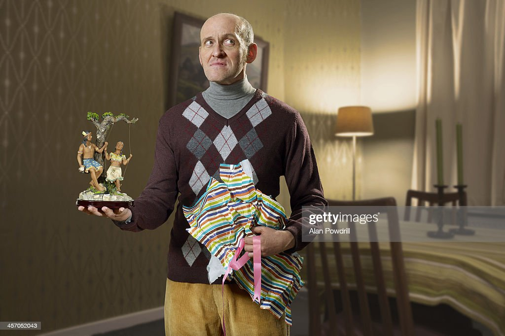 Portrait of man with unwrapped bad gift : Foto de stock