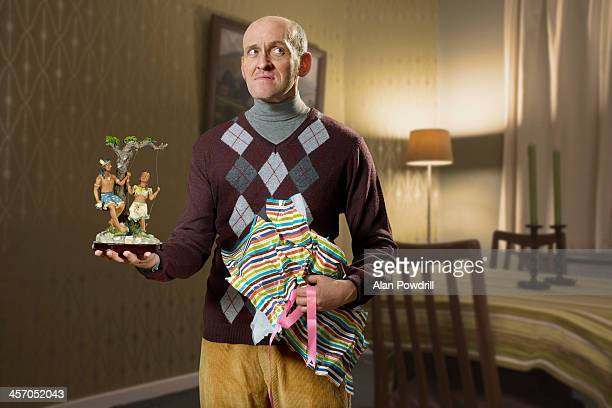 Portrait of man with unwrapped bad gift