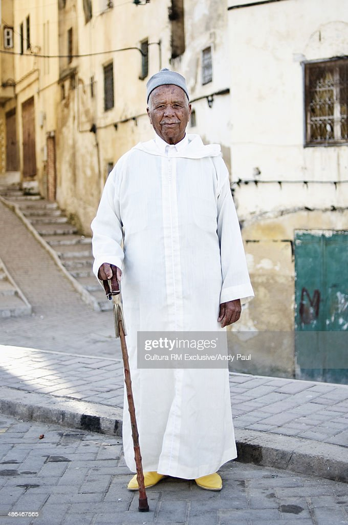 Portrait of man with walking stick, Fes Medina, Morocco