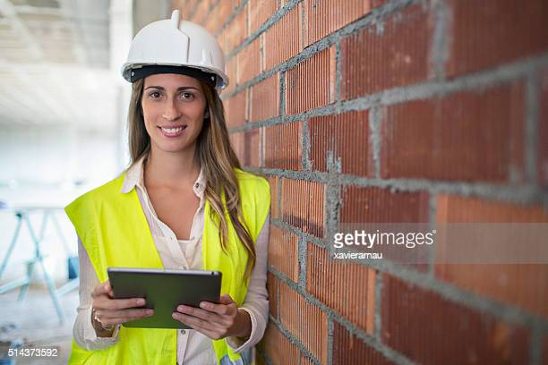 Portrait of manager with digital tablet on construction site