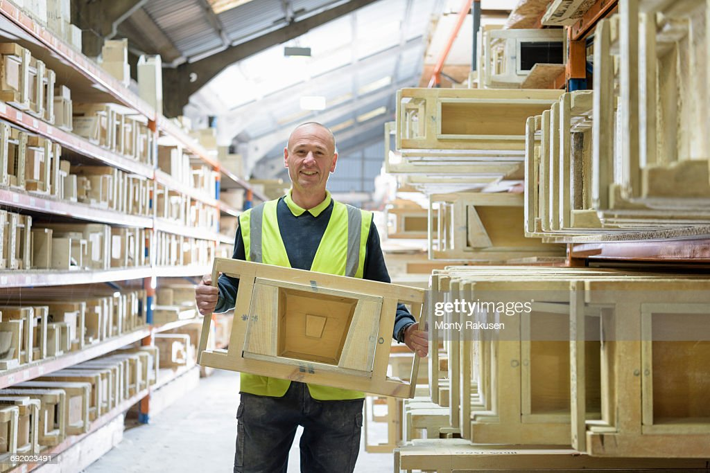 portrait of manager with stone moulds in architectural stone factory stock photo