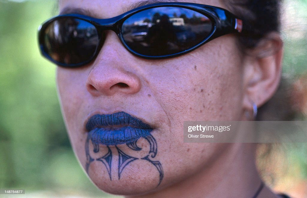 Portrait of Maori woman with moko (traditional tattoos).
