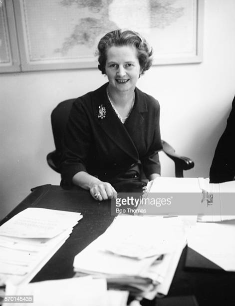 Portrait of Margaret Thatcher the newly appointed Joint Parliamentary Secretary to the Ministry of Pensions and National Insurance working at her...
