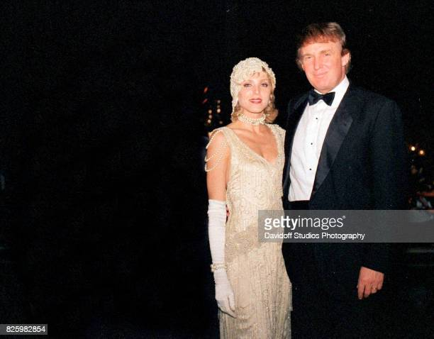Portrait of married American couple actress Marla Maples and real estate developer Donald Trump as they pose together during a 'roaring 20's' party...