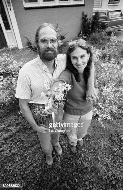 Portrait of married couple Stephen and Emelie Kenney as they pose amid the wild flowers in the yard of the suburban home Buffalo New York November 12...