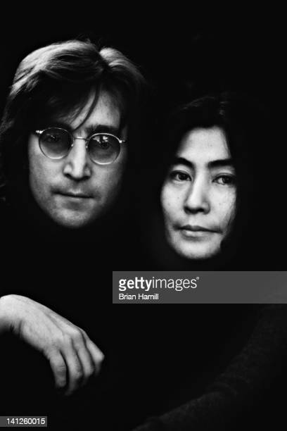 Portrait of married musicians John Lennon and Yoko Ono at their apartment New York New York 1972