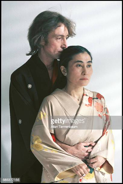 Portrait of married musicians John Lennon and Yoko Ono both dressed in kimonos in a SoHo gallery New York New York November 26 1980 The gallery was...
