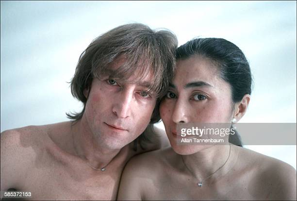 Portrait of married musicians John Lennon and Yoko Ono in a SoHo gallery New York New York November 26 1980 The gallery was one of several settings...