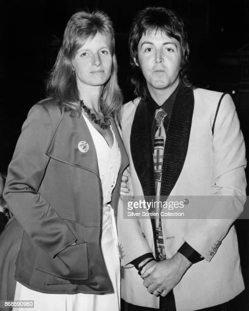 Portrait of married musicians Linda McCartney and Paul McCartney both from the group Wings mid to late 1970s Linda wears a pin that reads 'I've...