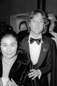Portrait of married musicians Yoko Ono and John Lennon as they arrive at the Kennedy Center for President Jimmy Carter's Inaugural Gala Washington DC...