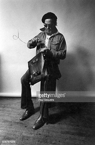 Portrait of master tailor and leather craftsman John 'Buffy' Strawn at work on a leather bag Chicago Illinois 1978