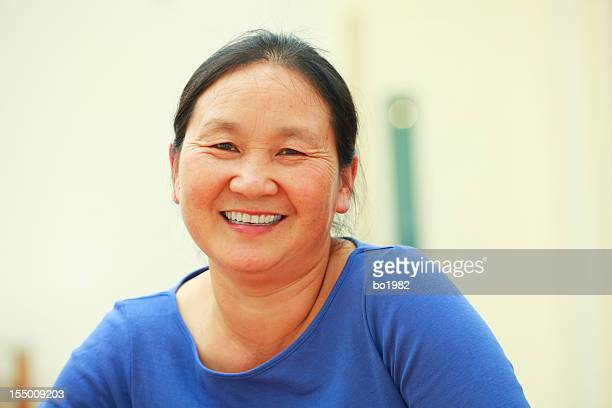 portrait of mature asian woman looking at camera smile