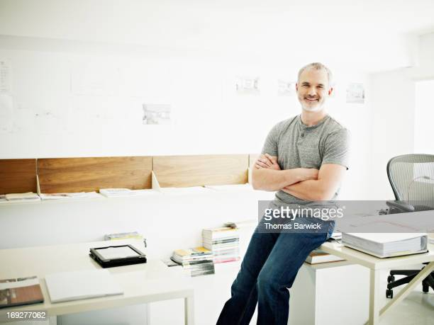 Portrait of mature businessman in startup office