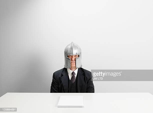 Portrait of mature businessman wearing helmet