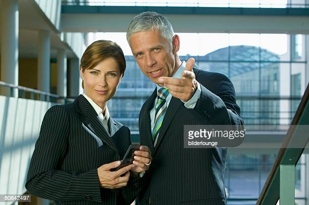 portrait of mature businesswoman and male colleague