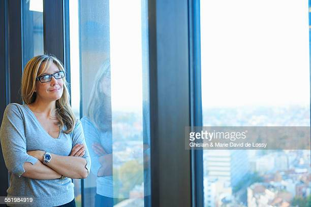 Portrait of mature businesswoman in skyscraper office, Brussels, Belgium