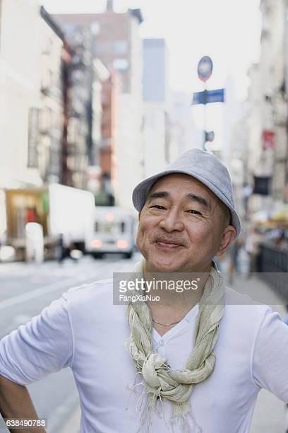 Portrait of mature Chinese man in downtown city