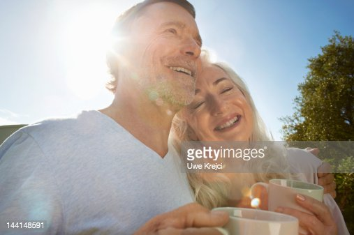 Portrait of mature couple, holding cups, close up : Stock Photo