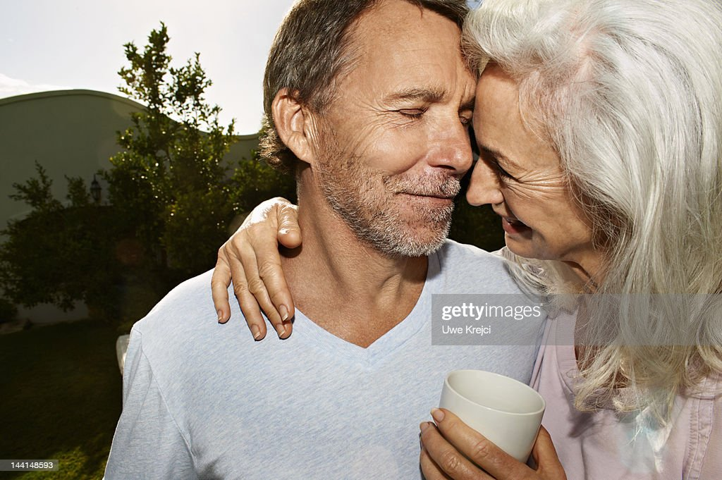 Portrait of mature couple in garden, close up : Stock Photo